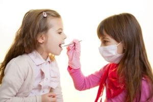 two girls playing dentist